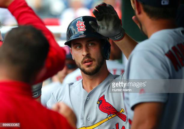 Paul DeJong of the St Louis Cardinals is congratulated by teammates in the dugout after hitting a solo home run in the eighth inning during a game...