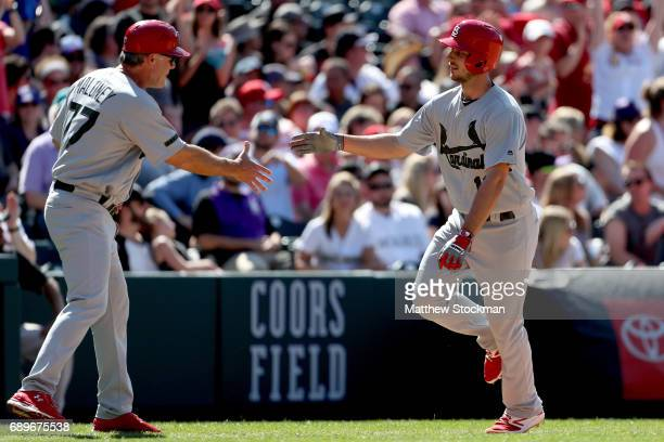 Paul DeJong of the St Louis Cardinals is congratulated by third base coach Chris Maloney after hiting a home run in the ninth inning against the...
