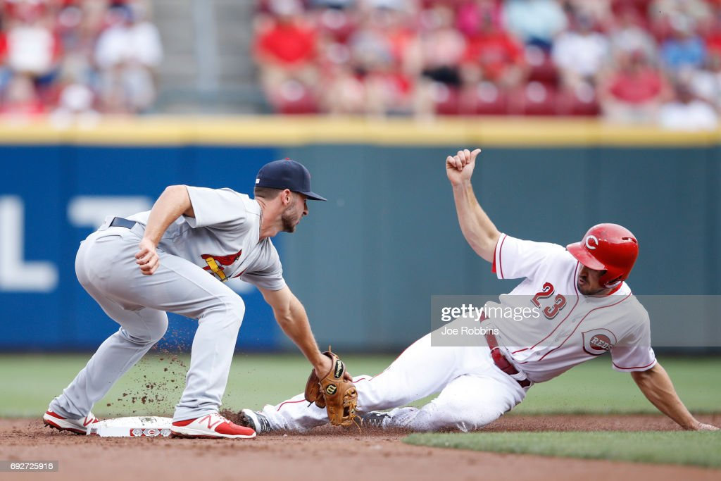 Paul DeJong #11 of the St. Louis Cardinals tags out Adam Duvall #23 of the Cincinnati Reds at second base in the second inning of a game at Great American Ball Park on June 5, 2017 in Cincinnati, Ohio.