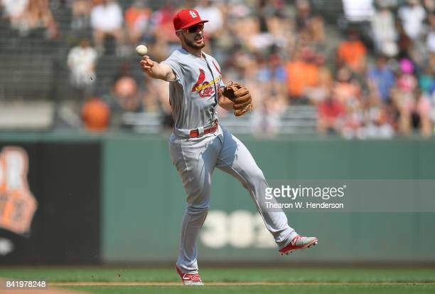 Paul DeJong of the St Louis Cardinals throws off balance to first base throwing out Gorkys Hernandez of the San Francisco Giants in the bottom of the...