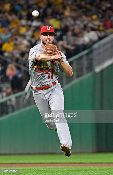 Paul DeJong of the St Louis Cardinals throws to first base to force out Starling Marte of the Pittsburgh Pirates in the fifth inning during the game...