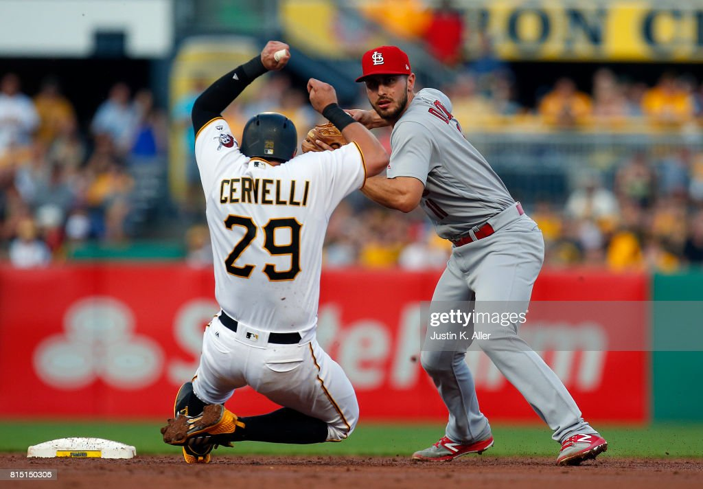Paul DeJong #11 of the St. Louis Cardinals turns a double play in the third inning against Francisco Cervelli #29 of the Pittsburgh Pirates during the game at PNC Park on July 15, 2017 in Pittsburgh, Pennsylvania.