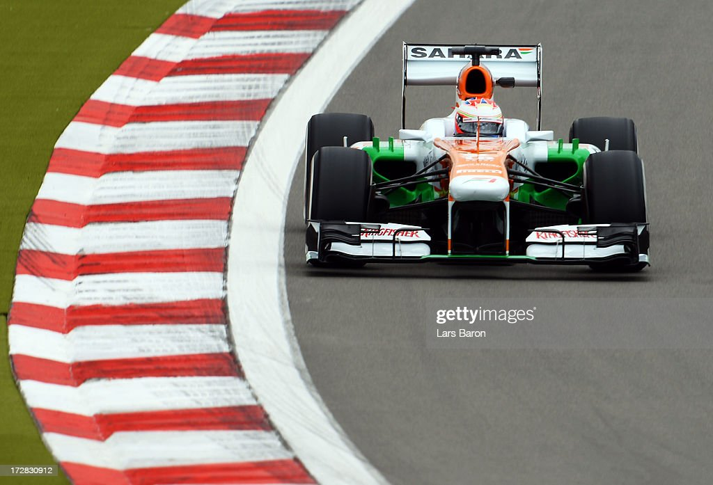 Paul di Resta of Great Britain and Force India drives during practice for the German Grand Prix at the Nuerburgring on July 5, 2013 in Nuerburg, Germany.