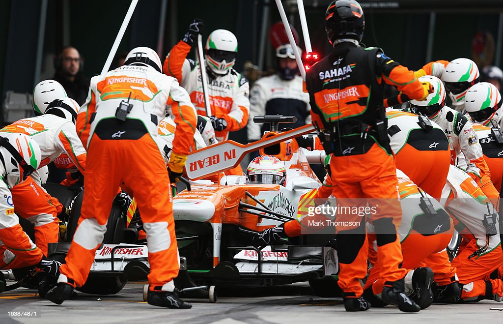 Paul di Resta of Great Britain and Force India drives in for a pitstop during the Australian Formula One Grand Prix at the Albert Park Circuit on March 17, 2013 in Melbourne, Australia.