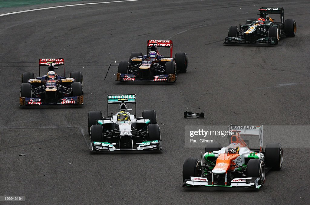 Paul di Resta of Great Britain and Force India leads a train of cars during the Brazilian Formula One Grand Prix at the Autodromo Jose Carlos Pace on November 25, 2012 in Sao Paulo, Brazil.