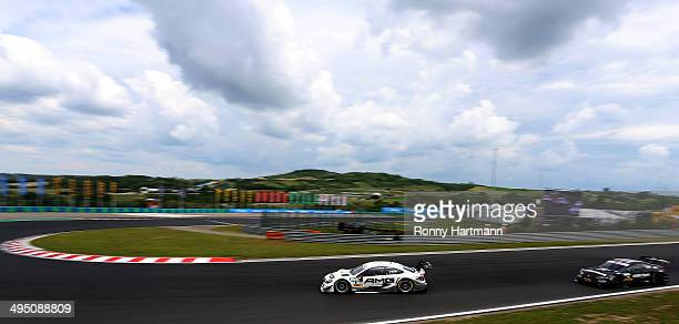 Paul di Resta of Great Britain and Mercedes AMG drives infront of Bruno Spengler of Canada and BMW Team Schnitzer during the third round of the DTM...
