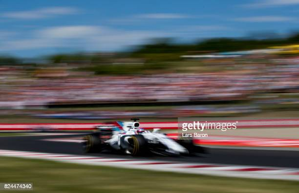 Paul di Resta of Great Britain driving the Williams Martini Racing Williams FW40 Mercedes on track during the Formula One Grand Prix of Hungary at...