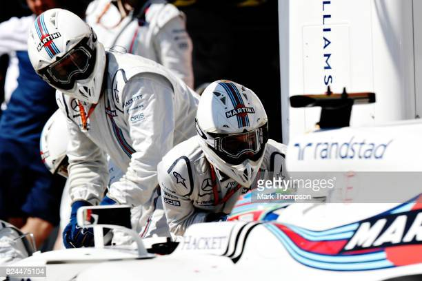 Paul di Resta of Great Britain driving the Williams Martini Racing Williams FW40 Mercedes makes a pit stop for new tyres during the Formula One Grand...