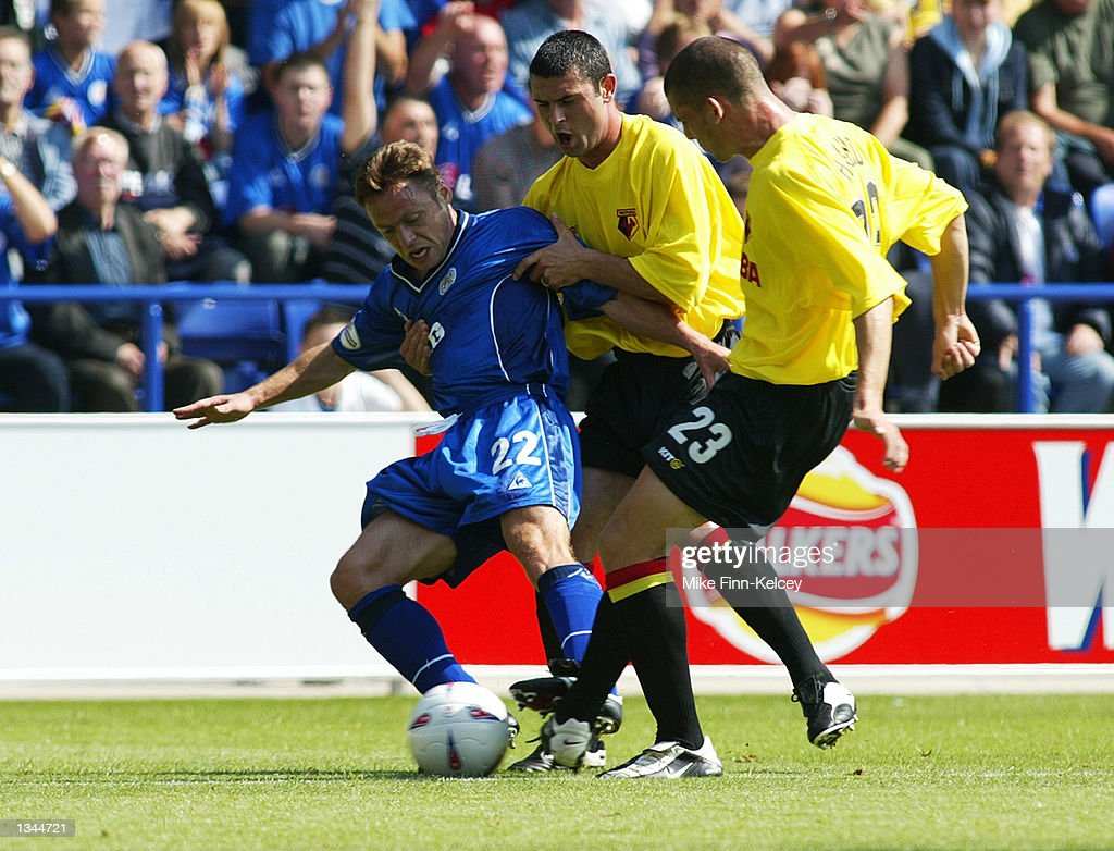 Paul Dickov of Leicester City holds off Paul Robinson and Jamie Hand of Watford in the Nationwide League Division One match between Leicester City and Watford at the Walkers Stadium in Leicester, England on August 10, 2002. Leicester won 2-0.