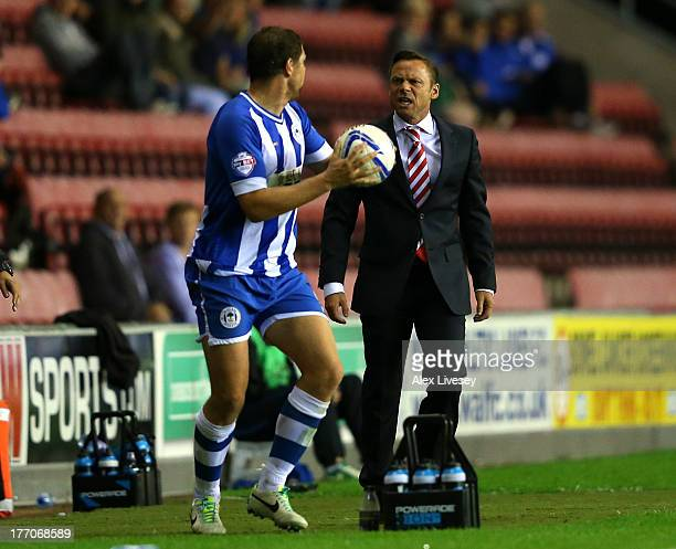 Paul Dickov the manager of Doncaster Rovers clashes with Grant Holt of Wigan Athletic during the Sky Bet Championship match between Wigan Athletic...