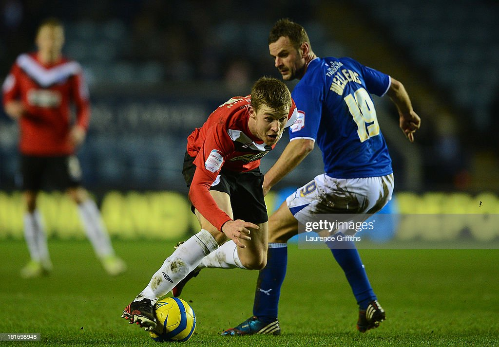 Paul Dixon of Huddersfield Town battles with Richie Wellens of Leicester City during the FA Cup with Budweiser Fourth Round replay match between Leicester City and Huddersfield Town at The King Power Stadium on February 12, 2013 in Leicester, England.
