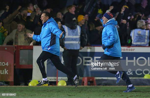 Paul Doswell manager of Sutton United celebrates after his team score to make it 12 during The Emirates FA Cup Third Round Replay match between AFC...