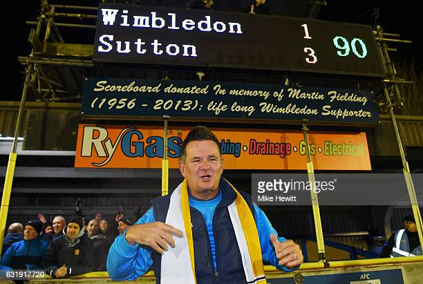 Paul Doswell Manager of Sutton United celebrates victory in front of the score board after the Emirates FA Cup third round replay between AFC...