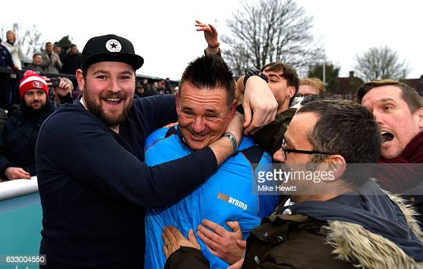 Paul Doswell Manager of Sutton United celebrates with the Sutton United fans on the pitch after The Emirates FA Cup Fourth Round match between Sutton...