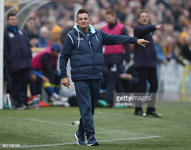 Paul Doswell Manager of Sutton United looks on during The Emirates FA Cup Third Round match between Sutton United and AFC Wimbledon at the Borough...