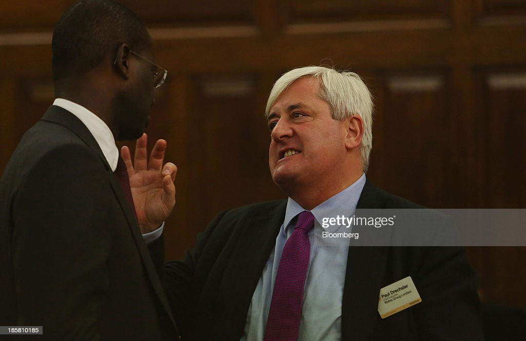 Paul Drechsler, chief executive officer of Wates Group Ltd., right, speaks with Tidjane Thiam, chief executive officer of Prudential Plc, during an event to mark the 125th anniversary of the Financial Times in London, U.K., on Thursday, Oct. 24, 2013. U.K. economic growth accelerated to its fastest pace in more than three years in the third quarter as the recovery continued across all main industries. Photographer: Chris Ratcliffe/Bloomberg via Getty Images
