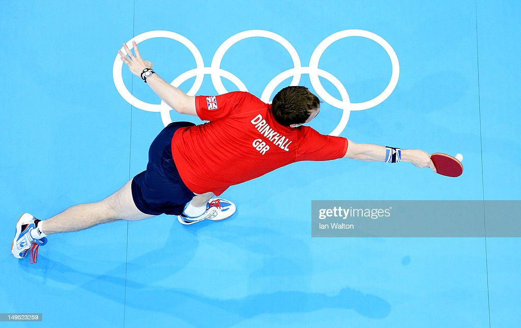 Paul Drinkhall of Great Britain stretches to return the ball during his Men's Singles Table Tennis third round match against Dimitrij Ovtcharov of Germany on Day 3 of the London 2012 Olympic Games at ExCeL on July 30, 2012 in London, England.