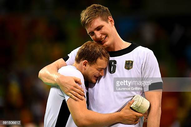 Paul Drux and Finn Lemke of Germany celebrate their victory after the Men's Quarterfinal Handball contest against Qatar at Future Arena on Day 12 of...