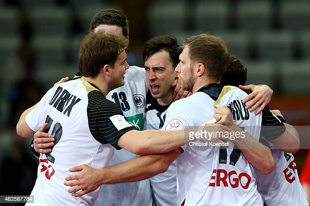 Paul Drux Erik Schmidt Patrick Groetzki and Steffen Weinhold of Germany celebrate after the eighth place match between Germany and Slovenia in the...