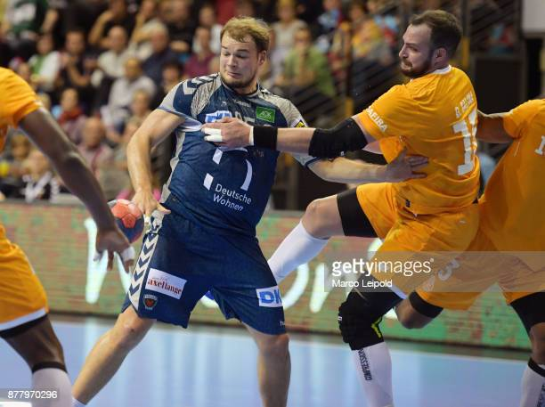 Paul Drux of Fuechse Berlin and Daymaro Salina of FC Porto during the EHF Cup match between Fuechse Berlin and the FC Porto at MaxSchmelingHalle on...