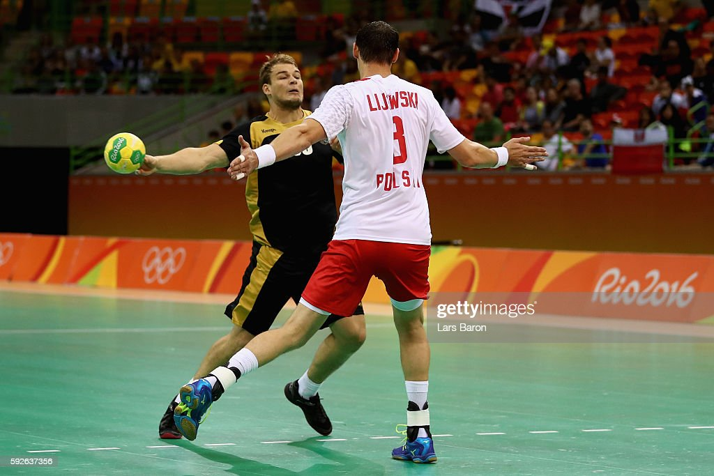 Paul Drux of Germany is blocked by Krzysztof Lijewski of Poland during the Men's Bronze Medal Match between Poland and Germany on Day 16 of the Rio...
