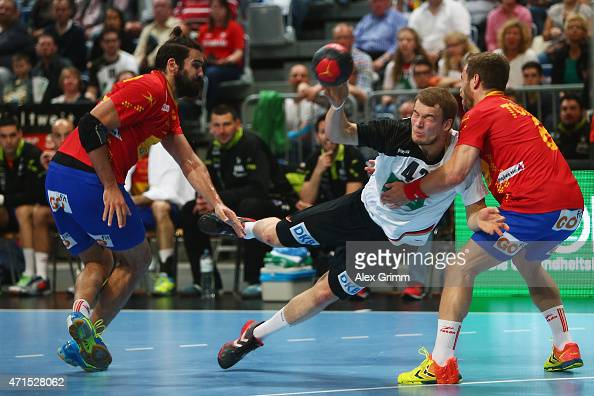 Paul Drux of Germany is challenged by Jorge Maqueda Pena 8l9 and Victor Tomas Gonzalez of Spain during the European Handball Championship 2016...