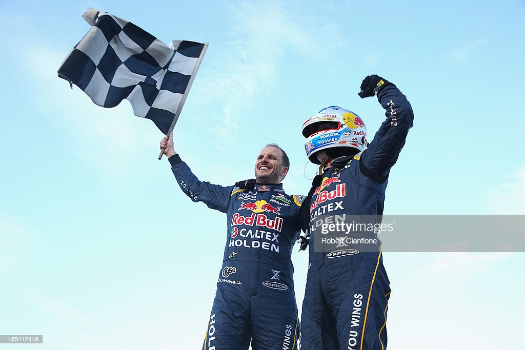 Paul Dumbrell and Jamie Whincup drivers the Red Bull Racing Australia Holden celebrate after they combined to win the Sandown 500 which is race 29 of...