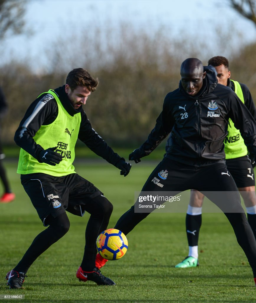 Paul Dummett (L) and Mohamed Diame (R) jostle for the ball during the Newcastle United Training session at the Newcastle Untied Training Centre on November 9, 2017 in Newcastle upon Tyne, England.