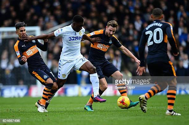 Paul Dummett of Newcastle United and Ayoze Perez close down Hadi Sacko of Leeds United during the Sky Bet Championship Match between Leeds United and...