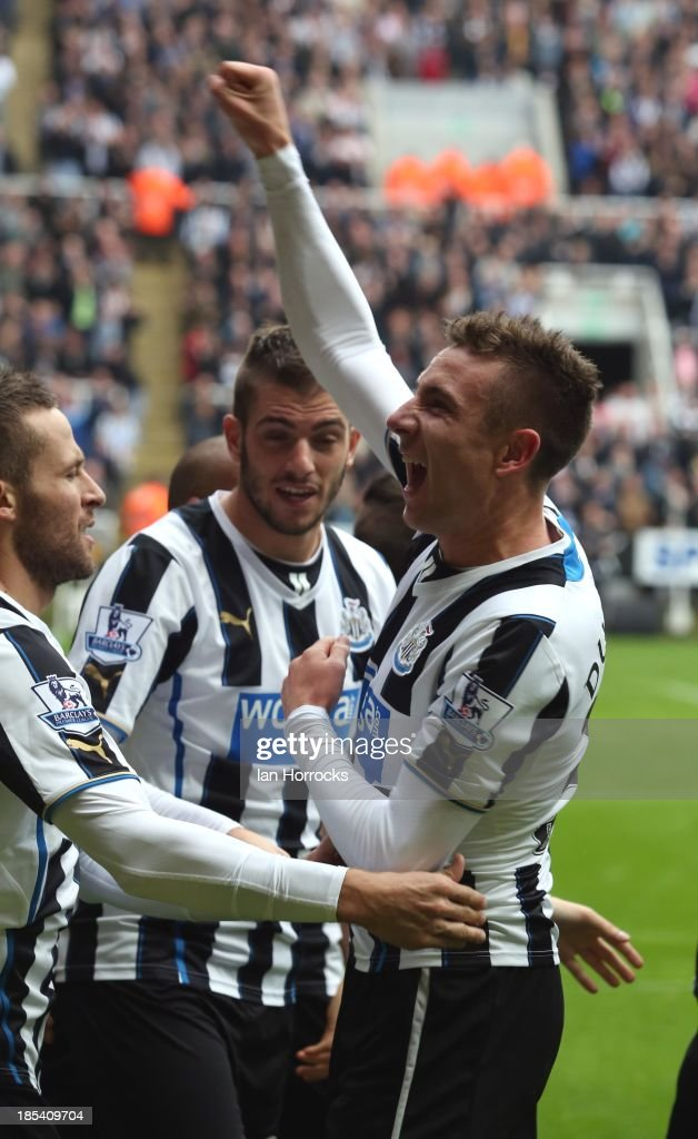 Paul Dummett of Newcastle United celebrates scoring the second Newcastle goal during the Barclays Premier League game between Newcastle United and Liverpool at St James' Park on October 19, 2013 in Newcastle upon Tyne, England.
