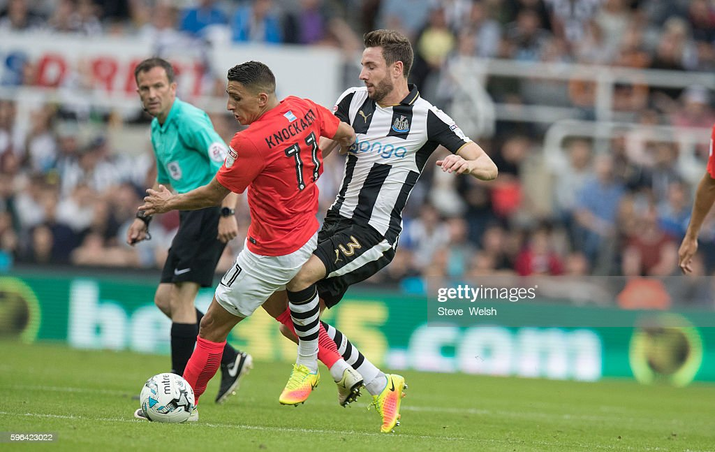 Paul Dummett of Newcastle United challenges Anthony Knockaert of Brighton during the Premier League match between Newcastle United and Brighton & Hove Albion on August 27, 2016 in Newcastle.