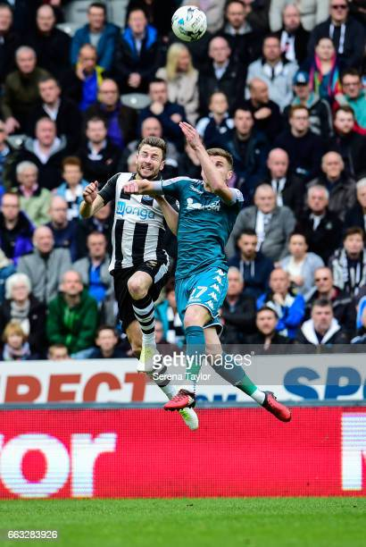 Paul Dummett of Newcastle United challenges Ryan Colclough of Wigan Athletic for a header during the Sky Bet Championship match between Newcastle...