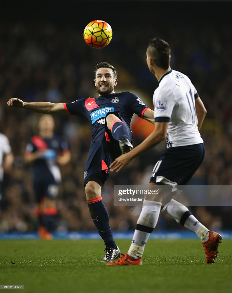Paul Dummett of Newcastle United clears the ball from Erik Lamela of Tottenham Hotspur during the Barclays Premier League match between Tottenham Hotspur and Newcastle United at White Hart Lane on December 13, 2015 in London, England.