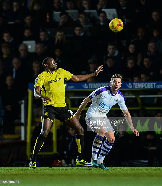 Paul Dummett of Newcastle United looks to challenge Lloyd Dyer of Burton Albion for the ball during the Sky Bet Championship match between Burton...