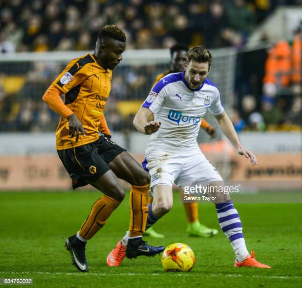 Paul Dummett of Newcastle United looks to close down Bright Enobakhare of Wolverhampton Wanderers during the Sky Bet Championship match between...