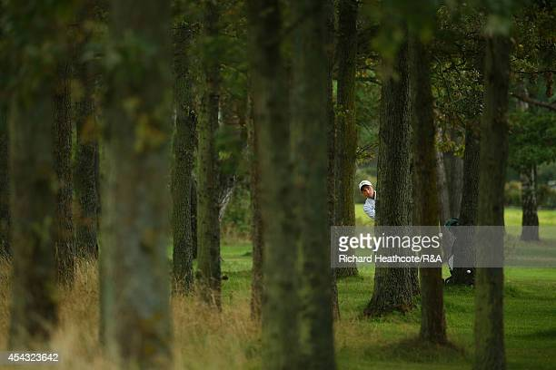 Paul Dunne of GBI plays from the trees on the 7th in his match with Gary Hurley against Darius van Driel and Albert Eckhardt of Europe during the...