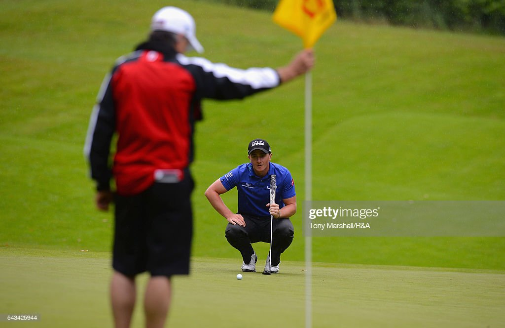 Paul Dunne of Hartl Resort lines up his putt on the 17th green during the Open Championship Qualifying - Woburn at Woburn Golf Club on June 28, 2016 in Woburn, England.