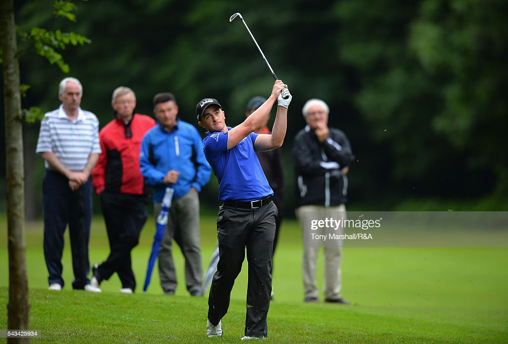 Paul Dunne of Hartl Resort plays his second shot on the 16th fairway during the Open Championship Qualifying - Woburn at Woburn Golf Club on June 28, 2016 in Woburn, England.