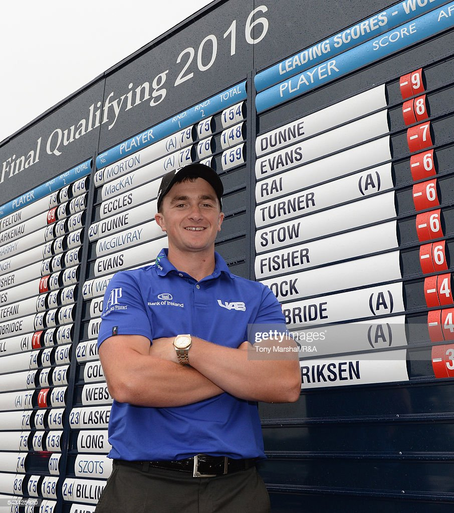 Paul Dunne of Hartl Resort poses next to the scoreboard after finishing as the leading qualifier during the Open Championship Qualifying - Woburn at Woburn Golf Club on June 28, 2016 in Woburn, England.
