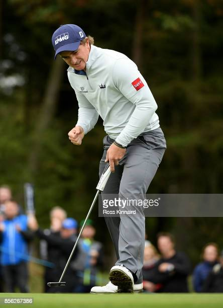 Paul Dunne of Ireland celebrates after making birdie on the 17th hole during day four of the British Masters at Close House Golf Club on October 1...