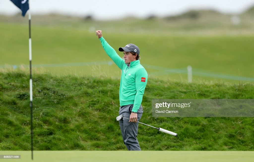 Paul Dunne of Ireland holes his second shot on the 16th hole for a birdie during the second round of the 2017 Alfred Dunhill Links Championship on the Championship Links at Carnoustie on October 6, 2017 in Carnoustie, Scotland.