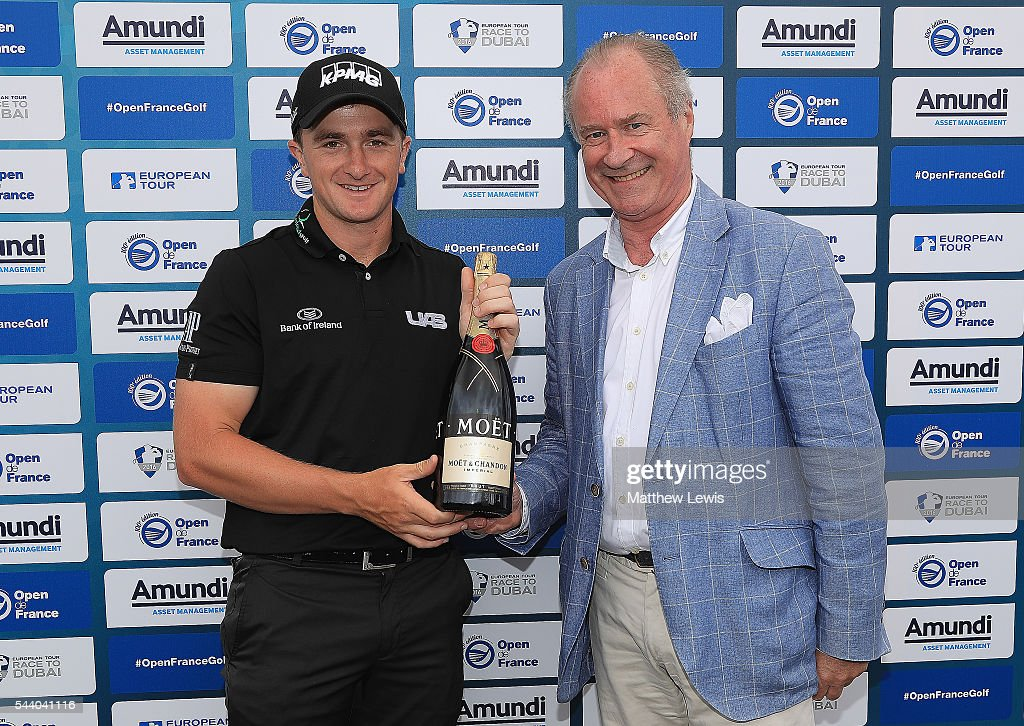 <a gi-track='captionPersonalityLinkClicked' href=/galleries/search?phrase=Paul+Dunne&family=editorial&specificpeople=5481664 ng-click='$event.stopPropagation()'>Paul Dunne</a> of Ireland is presented with a Magnum of champagne by Arnaud Jacquinet, Head of Operations for Moet & Chandon France, after his hol in one on the 8th hole during day two of the 100th Open de France at Le Golf National on July 1, 2016 in Paris, France.