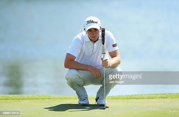 Paul Dunne of Ireland lines up a putt on the 9th green during day one of the Alfred Dunhill Championship at Leopard Creek Country Golf Club on...