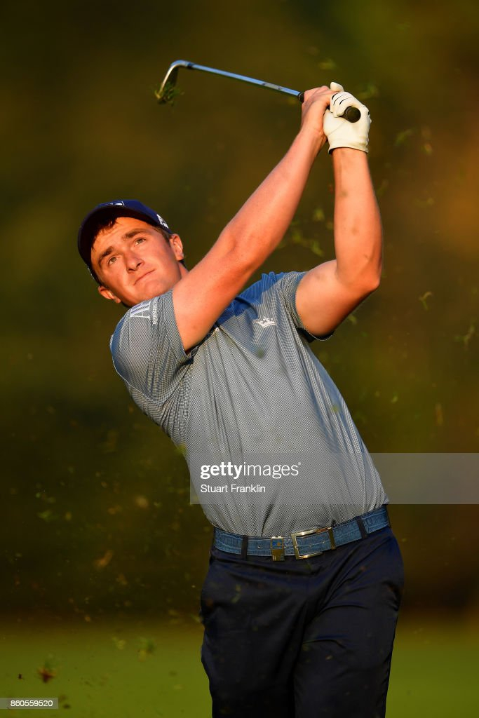 Paul Dunne of Ireland plays a shot on Day One of the Italian Open at Golf Club Milano - Parco Reale di Monza on October 12, 2017 in Monza, Italy.