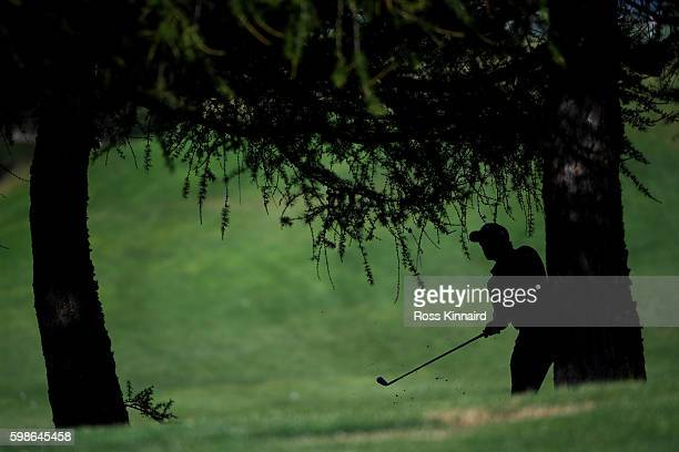 Paul Dunne of Ireland plays his second shot on the 12th hole during the second round of the Omega European Masters at CranssurSierre Golf Club on...