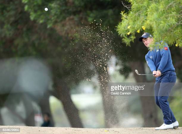 Paul Dunne of Ireland plays his second shot on the second hole during the second round of the 2017 Omega Dubai Desert Classic on the Majlis Course at...