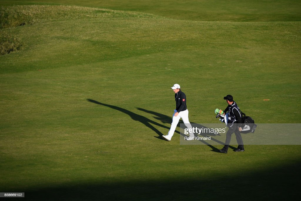 Paul Dunne of Ireland walks down the 9th fairway with his caddie during day three of the 2017 Alfred Dunhill Championship at Kingsbarns on October 7, 2017 in St Andrews, Scotland.