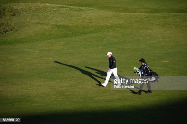 Paul Dunne of Ireland walks down the 9th fairway with his caddie during day three of the 2017 Alfred Dunhill Championship at Kingsbarns on October 7...
