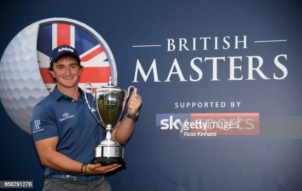 Paul Dunne of Ireland with the winners trophy after the final round of the British Masters at Close House Golf Club on October 1 2017 in Newcastle...