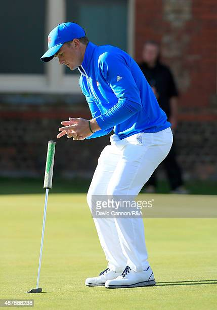 Paul Dunne of the Great Britain and Ireland Team reacts in agaony as his birdie putt lips out on the 18th hole in his match against Hunter Stewart of...